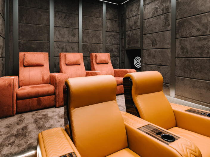 Home cinema with red and orange recliners